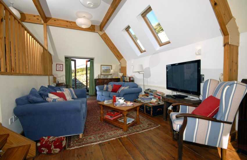Southerndown holiday house near Dunraven Bay - mezzanine sitting room with french doors to the gardens