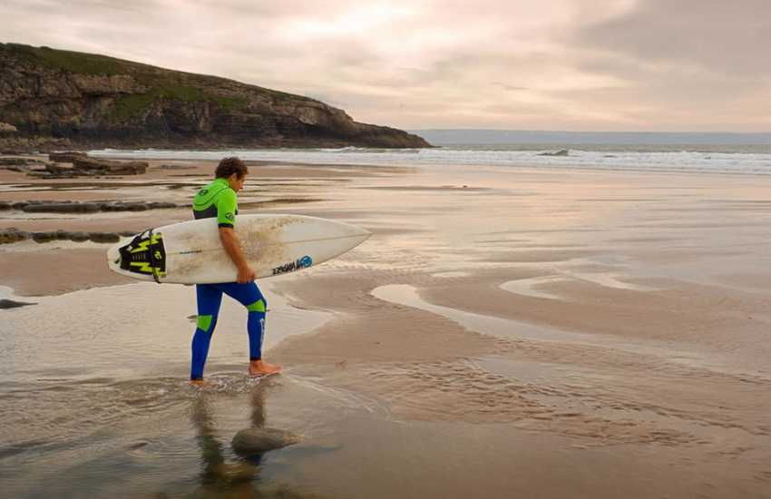 Surfers take to the waves at Dunraven Bay (Blue Flag) on the Wales' beautiful south coast