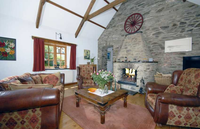 Holiday cottage in Wales - comfy lounge with open fireplace
