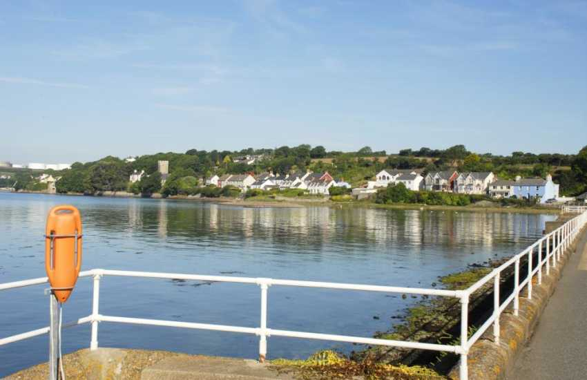 Superb panoramic views across the Milford Haven waterway and to the little villages of Llanstadwell and Hazelbeach from The Promenade at Brunels Cottage