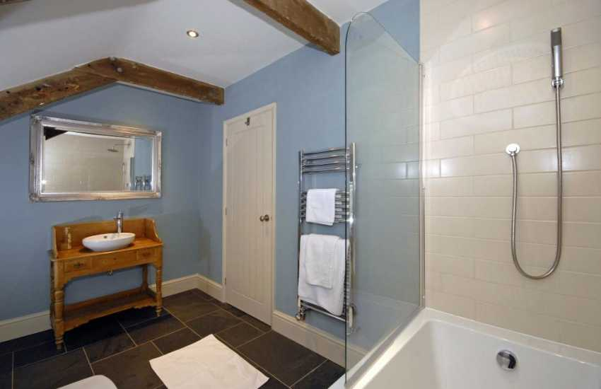 St Davids holiday cottage - family bathroom with shower over bath