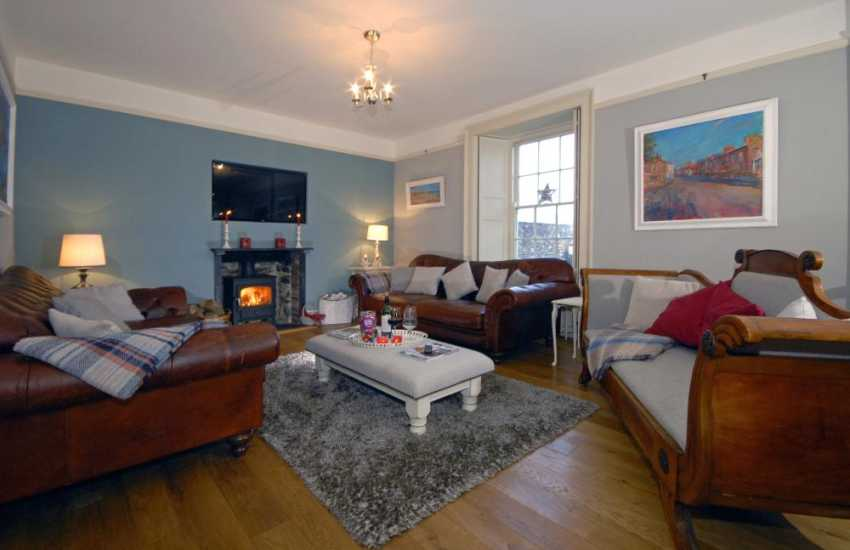 St Davids restored Welsh farmhouse - comfortable sitting room with wood burning stove