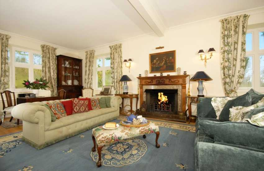 Carmarthenshire Edwardian country home on the River Tywi - drawing room with open log fire