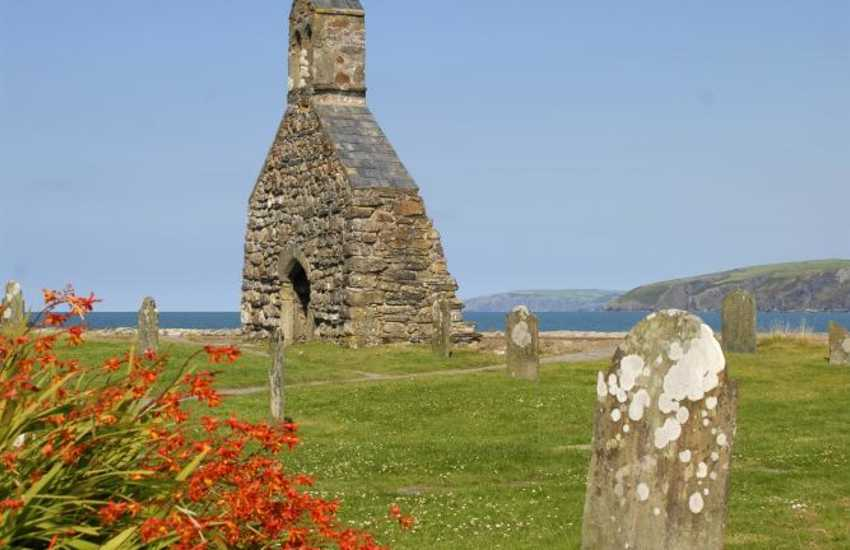 The 12th century church of St Brynach, destroyed during a storm, overlooks the beach at Cwm Yr Eglwys