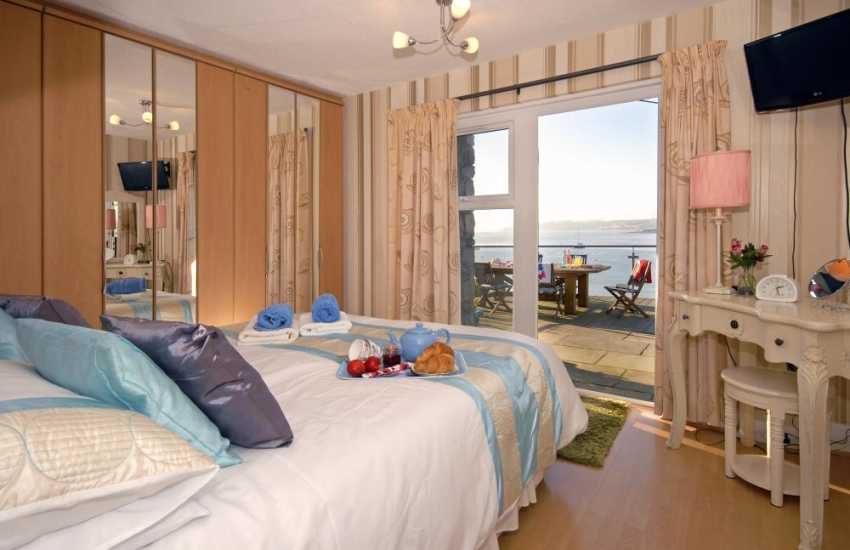 South Pembrokeshire holiday home - double bedroom with French doors to the deck