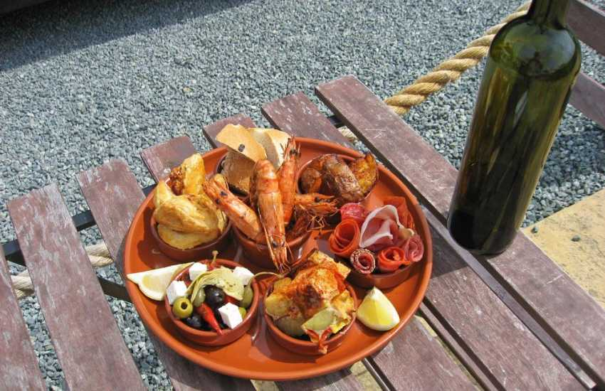 Head to The Wavecrest Cafe, Angle Beach for some delicious fresh seafood or share a plate of tapas in the sunshine