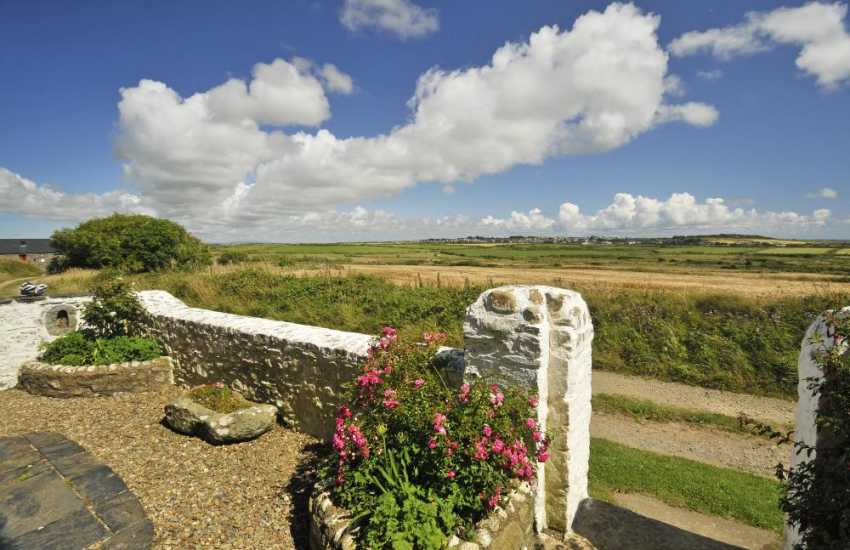 Enjoy fabulous views from Wdig Farmhouse across moorland to St Davids and the coast beyond