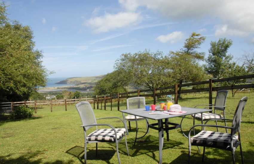 Enjoy breathtaking views over surrounding countryside and Newport Bay from the gardens