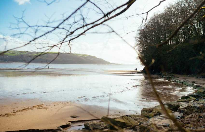 Llansteffan Beach is a sandy bay on the edge of the Towy Estuary