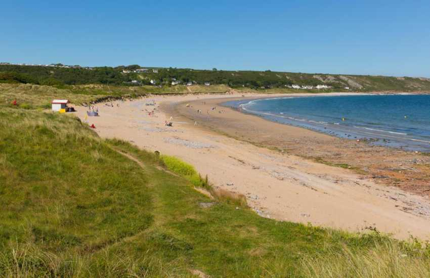 Port Eynon beach is a generous  sweep of south-facing sand, dunes, pebbles and rock pools