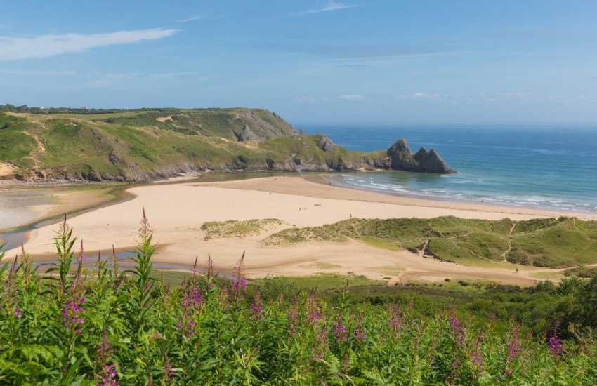Three Cliffs Bay for stunning scenery one of the most beautiful beaches in South Wales and dog friendly all year round