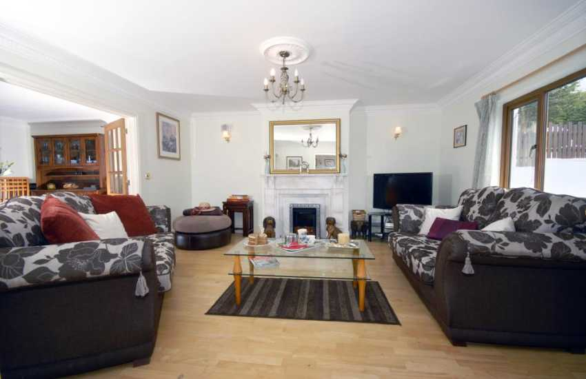 Teifi Valley modern holiday house - lounge leading to the dining room and conservatory