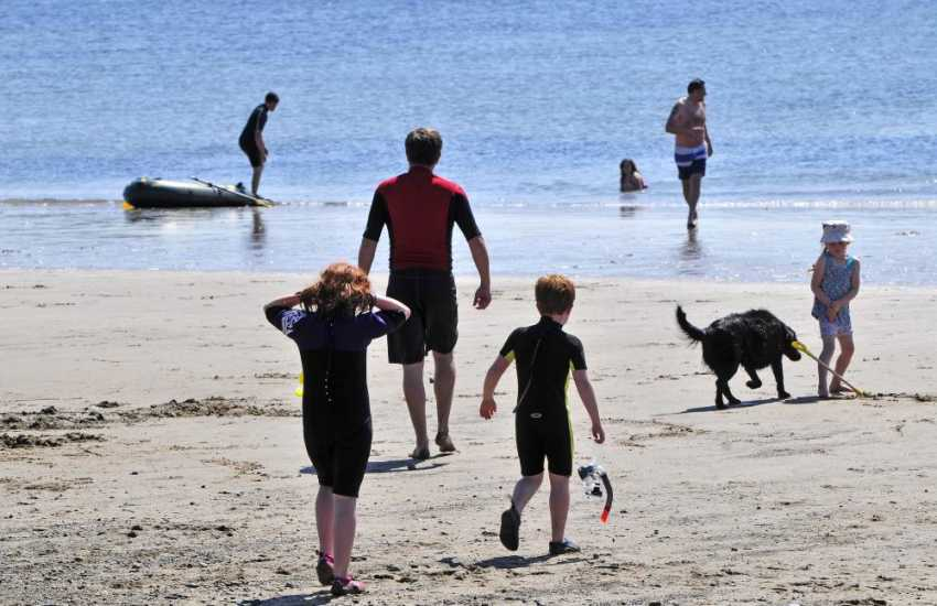 Borth has a long sand and shingle beach - popular with families and surfers all year round
