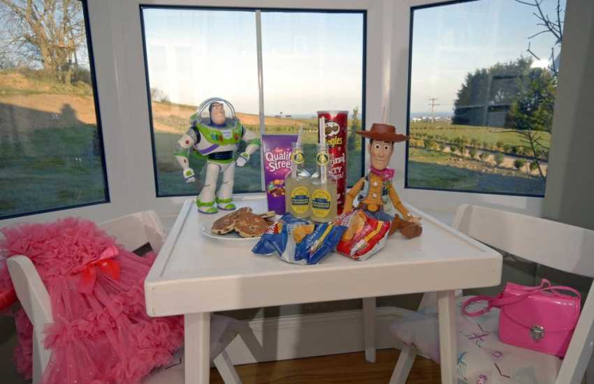 Buzz Lightyear and Woody join the picnic in the play-room