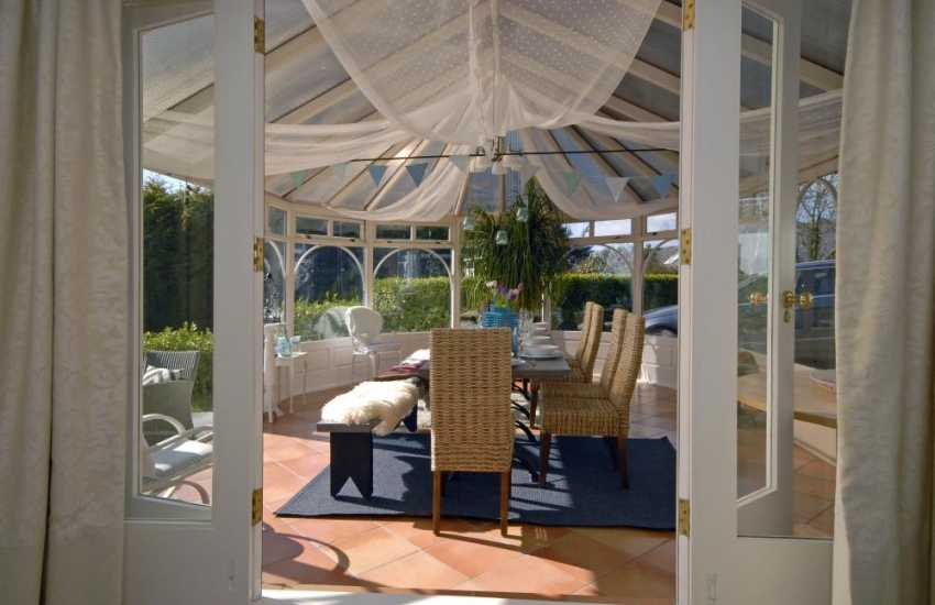 Pembrokeshire coastal holiday home - sitting room with conservatory