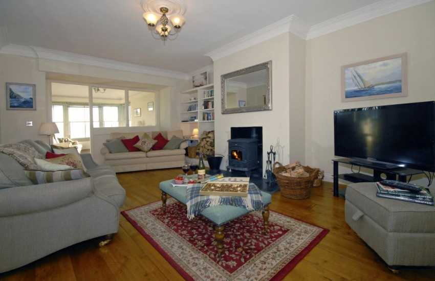 Pet friendly Pembrokeshire 'Secret Waterway' holiday home - sitting room with wood burning stove and sky t.v