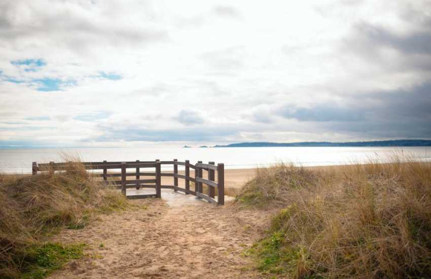 The sweeping waterfront of Swansea Bay leads to Mumbles and the beautiful Gower Peninsula