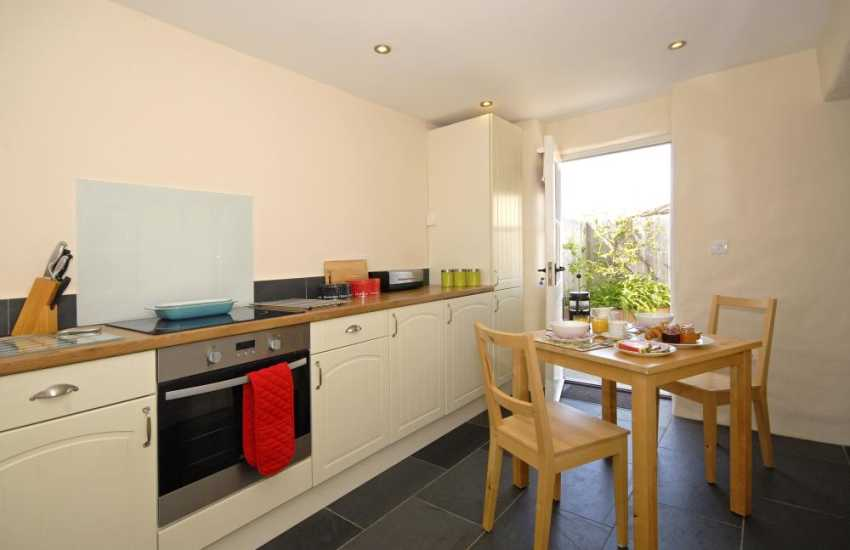 Self catering cottage St Davids - kitchen/diner with door to patio
