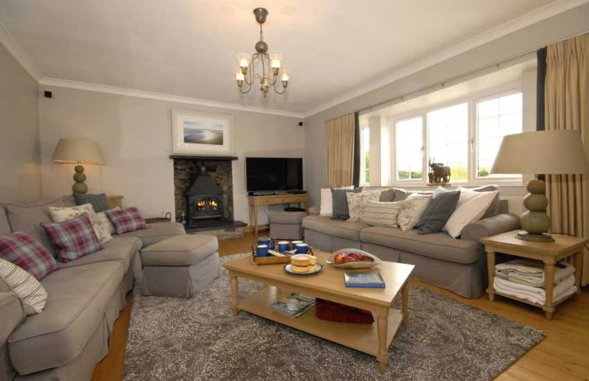 Elegant Carmarthenshire holiday house - spacious sitting room with wood burning stove