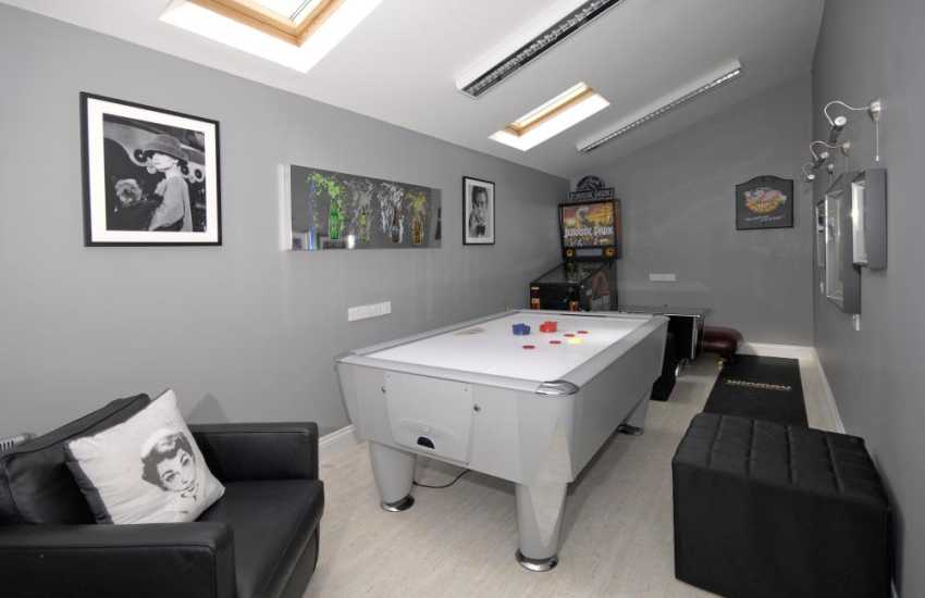 Laugharne holiday house - games room with ice hockey, t.v. darts, pinball machine and game console