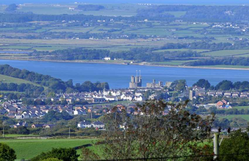 Caernarfon with the coastline of Anglesey in the distance