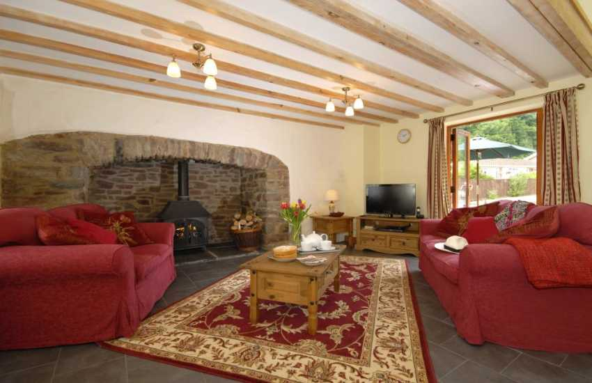 Pet friendly Laugharne holiday cottage - cosy sitting room with ignlenook log burning stove
