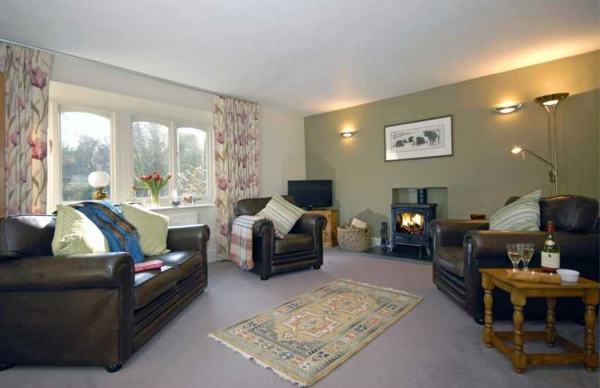 Pembrokeshire Coastal cottage - sitting/dining room with wood-burning stove