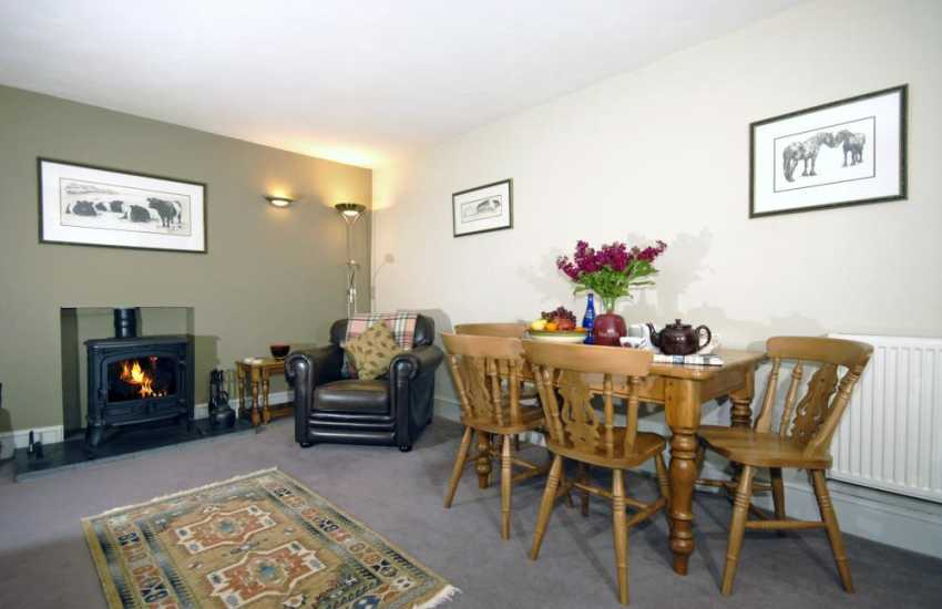 Pembrokeshire Coastal cottage - sitting/dining room with wood-burning stove