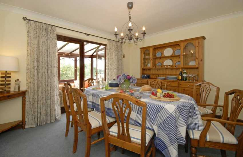 Tywi River holiday home - dining room off the covservatory