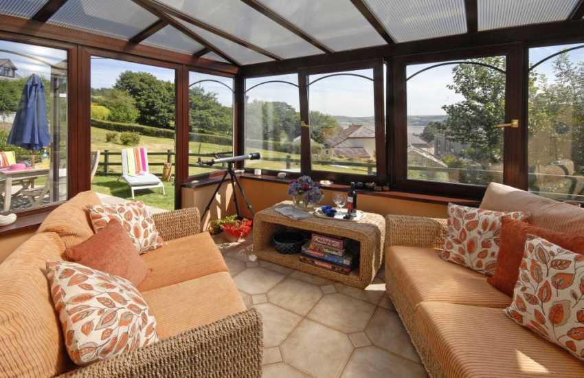 Llansteffan holiday house - conservatory with views over the village to the beach beyond