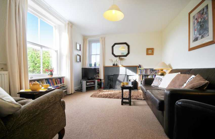 Lounge with garden views and open fire North Wales holiday cottage
