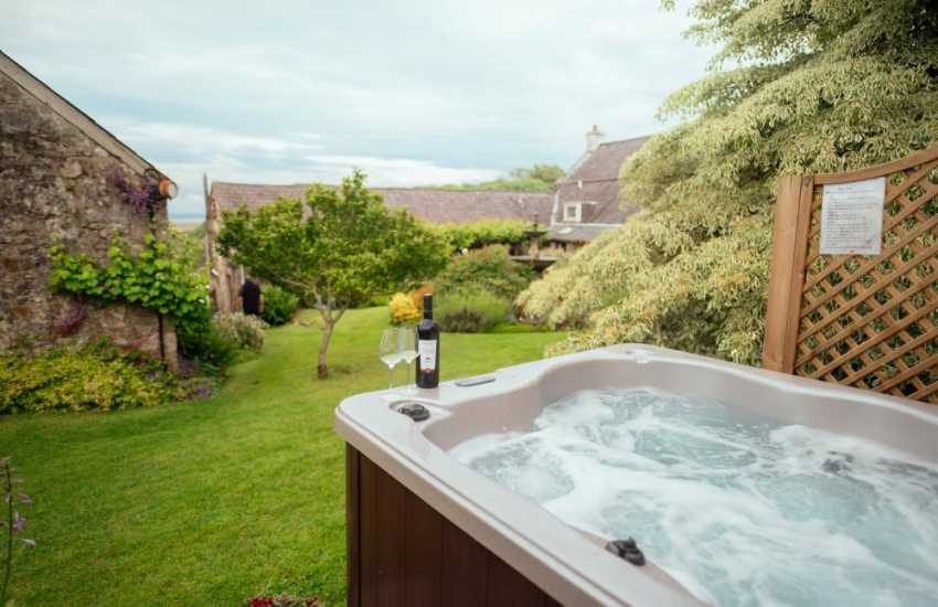 At the end of a busy day exploring Llanmadoc relax in the Hot Tub