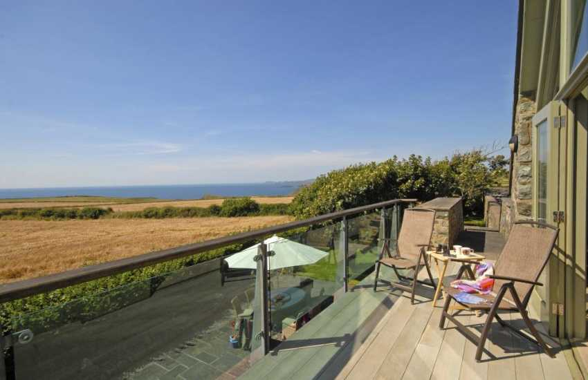 Tyr Tonnau 'House of the Waves' - stunning coastal views across St Brides Bay from the glass balustrade balcony