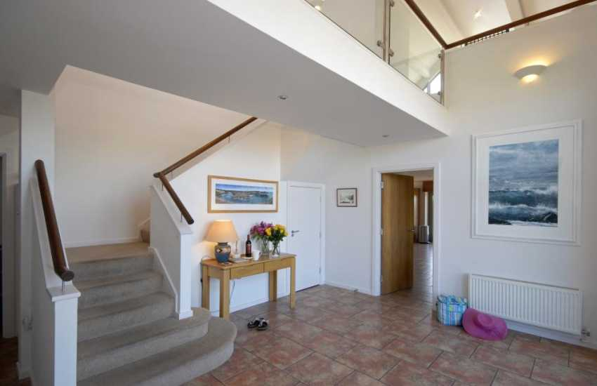 Solva modern barn conversion - entrance hall with glass balustrade gallery