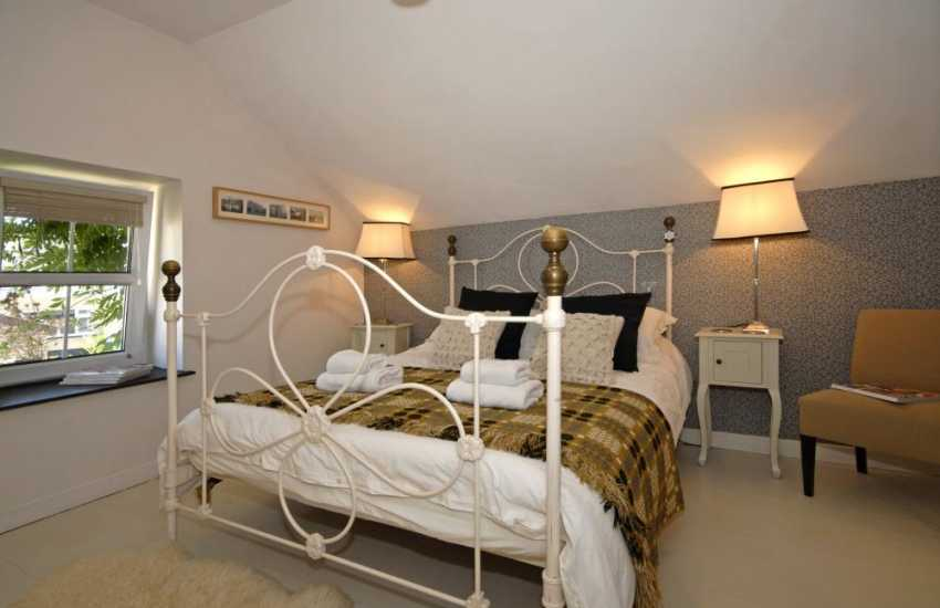 Carmarthenshire restored holiday barn - king size master bedroom with T.V. and en suite shower