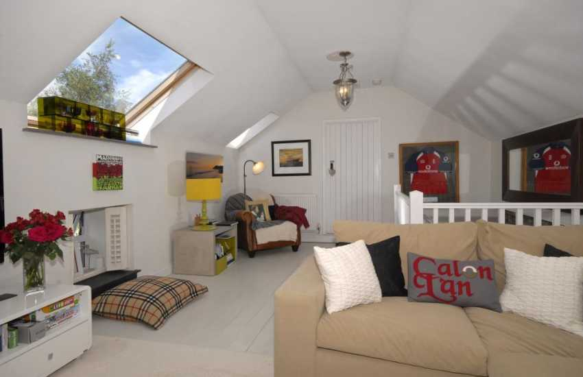 Llanybri holiday cottage near the beach - first floor spacious sitting room with Welsh soft furnishings