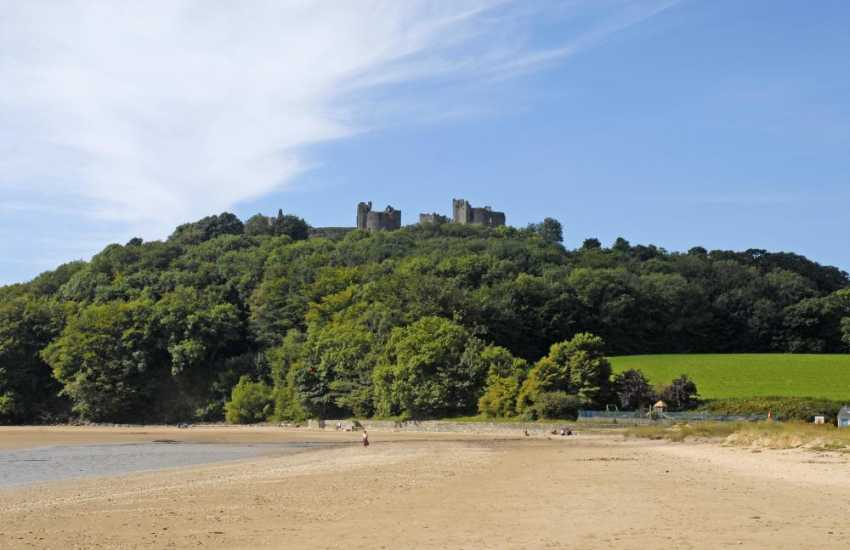 Llansteffan Castle sits in the trees high above the beach - well worth a visit