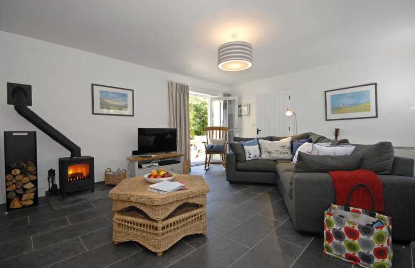 Newport Pembrokeshire holiday cottage - open plan sitting room with wood burning stove