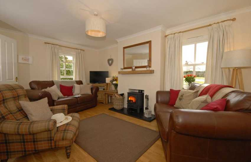 St Davids, Pembrokeshire holiday cottage - cosy sitting room with T.V. and wood burning stove