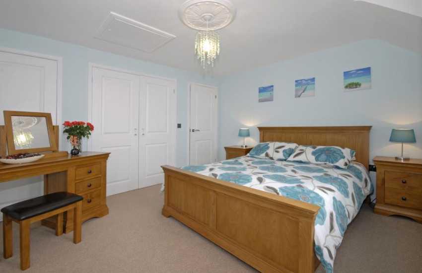 St Davids holiday house - master king size bedroom with en-suite shower
