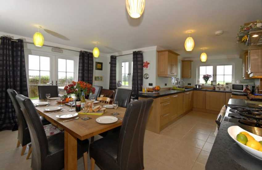 Self- catering holiday cottage Solva - open plan kitchen/dining room with French doors to garden