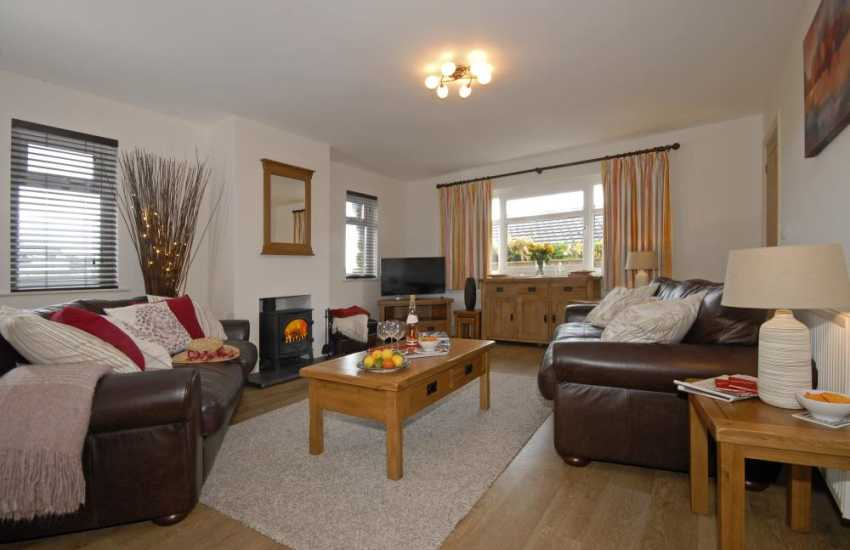 Manorbier coastal holiday home - sitting room with wood burning stove