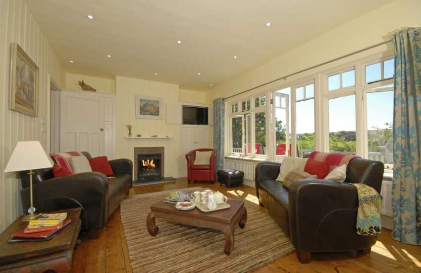 South Pembrokeshire holiday cottage sitting room with french doors to South facing deck