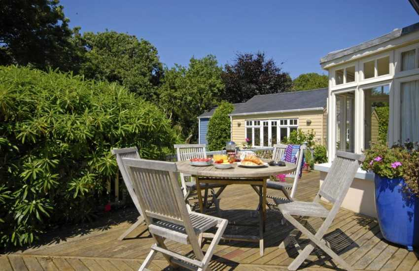 Pet friendly Manorbier holiday cottage - deck overlooking the private garden