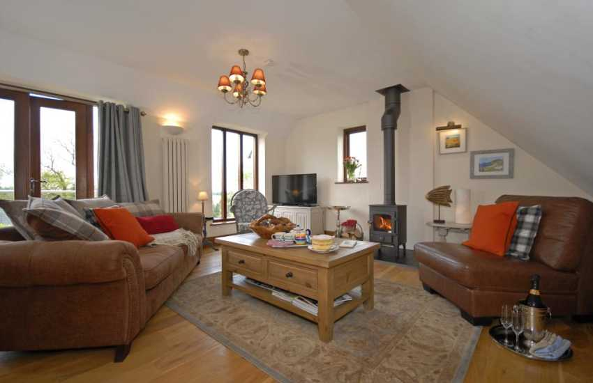 Stackpole Pembrokeshire modern holiday cottage - first floor sitting room with wood burning stove