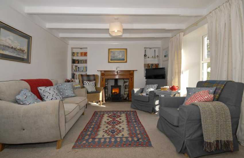 Solva, Pembrokeshire holiday Cottage - cosy sitting room with Wifi, T.V. and wood burning stov
