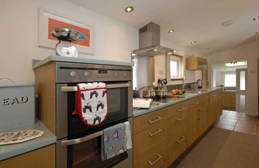 Self catering Solva cottage - contemporary galley fitted kitchen