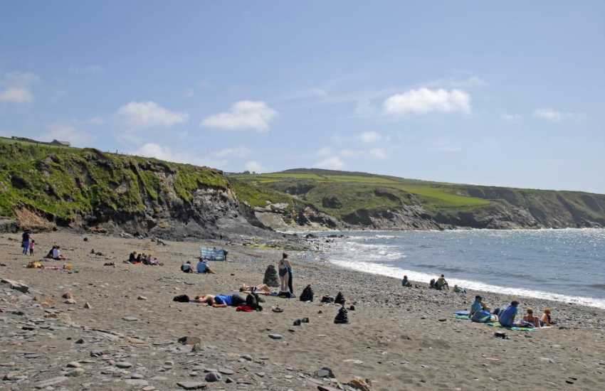 Abereiddy just north of St Davids is a popular, family friendly, sand and pebble beach with low rocks and cliffs