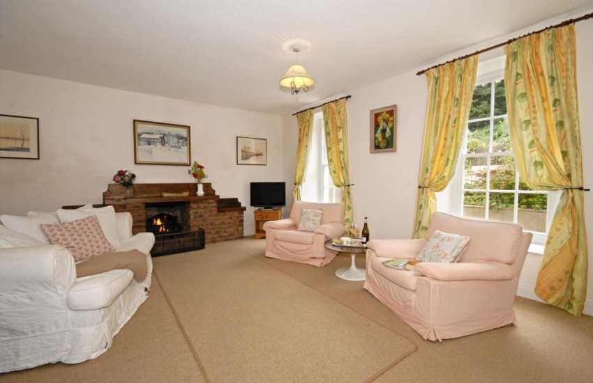 Pembrokeshire holiday house family room with tv & dvd player and open fireplace