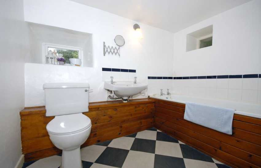 Solva Holiday Cottage - family bathroom with separate shower area
